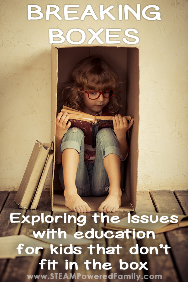 Child sitting in a box reading. Exploring the issues with education for kids that don't fit