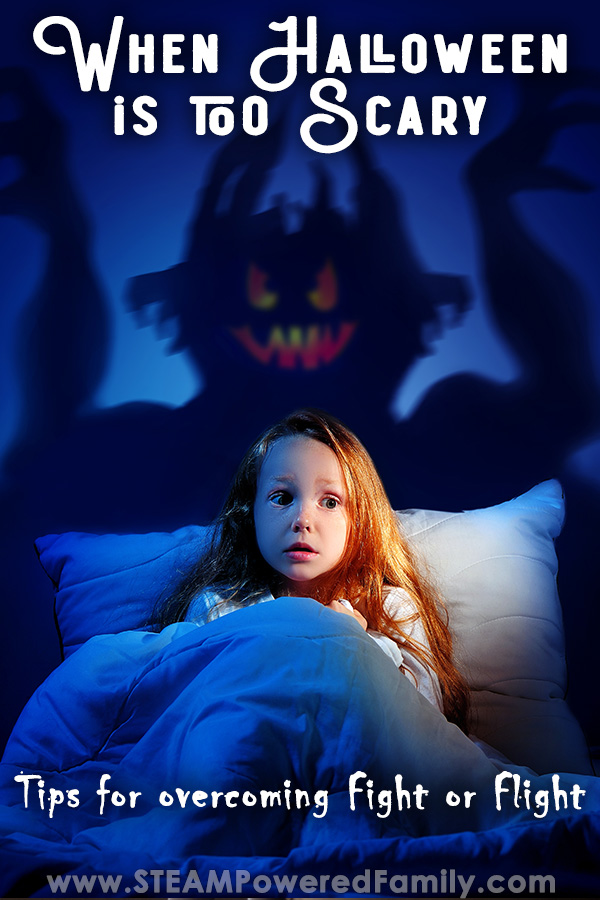 A scared girl curls under the blankets in fear as a shadowy devil looking creature looms in the shadows. Overlay text says When Halloween is too Scary. Tips on how to overcome Fight or Flight