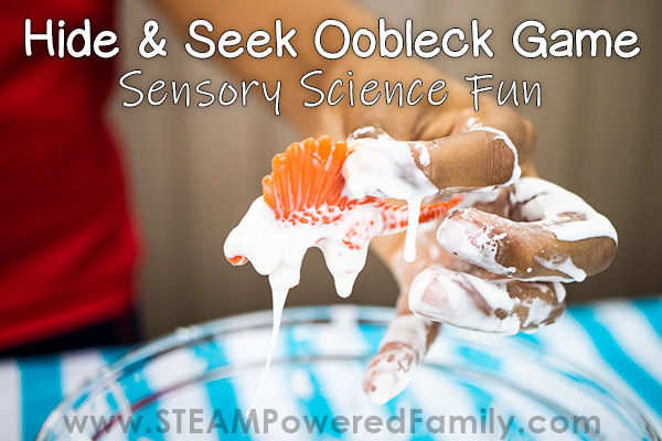 Orange dinosaur covered in Oobleck is held by a boy. Overlay text says Hide and Seek Oobleck Sensory Science Game