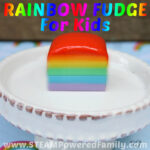 Simple rainbow fudge recipe that looks amazing, tastes delicious, and is so simple even kids can make it themselves!