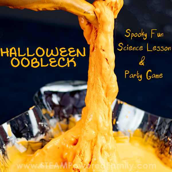 Oobleck with spider webs in a spider Halloween oobleck recipe