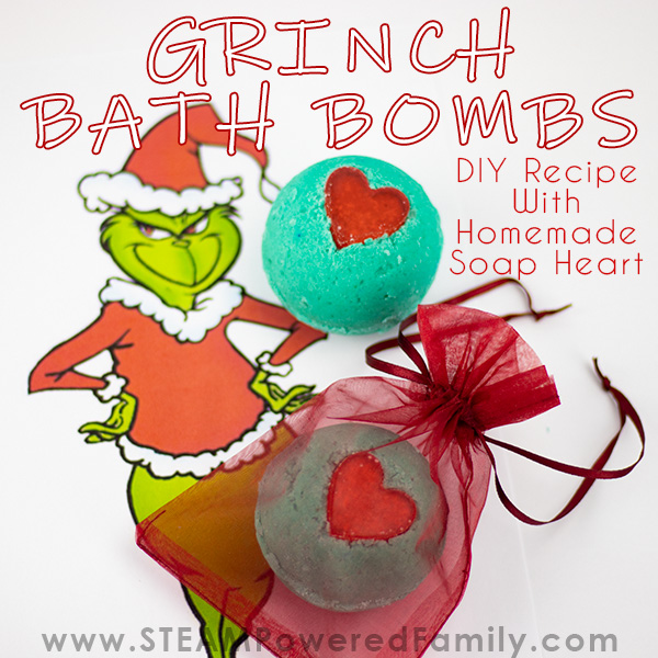 Grinch inspired Christmas bath bombs with red soap heart