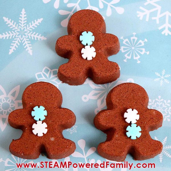 Gingerbread man bath bombs being decorated