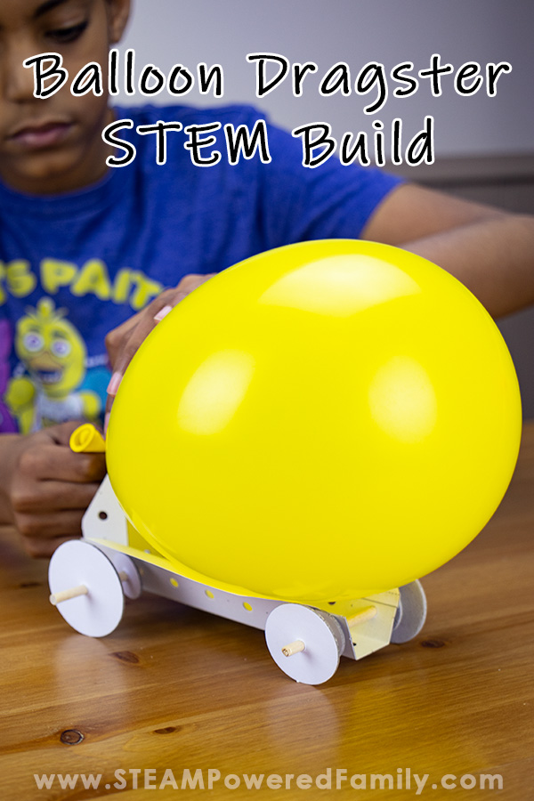 How to Build a Car STEM challenge has a boy preparing to launch a balloon powered dragster car he just built. The balloon is bright yellow and it is ready to launch.