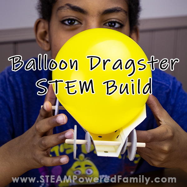 A boy is smiling as he blows up a yellow balloon in a dragster car build. Overlay text says Balloon Dragster STEM Build