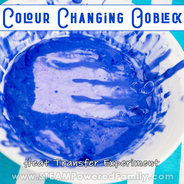 On a teal and white striped background sits a white bowl filled with blue oobleck that has a purple handprint in the centre. Overlay text says Colour Changing Oobleck a Heat Transfer Experiment