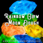 On a black background moon dough glows in a variety of colours - blue, green, orange, yellow and darker greens and blues. Overlay text says Rainbow Glow Moon Dough