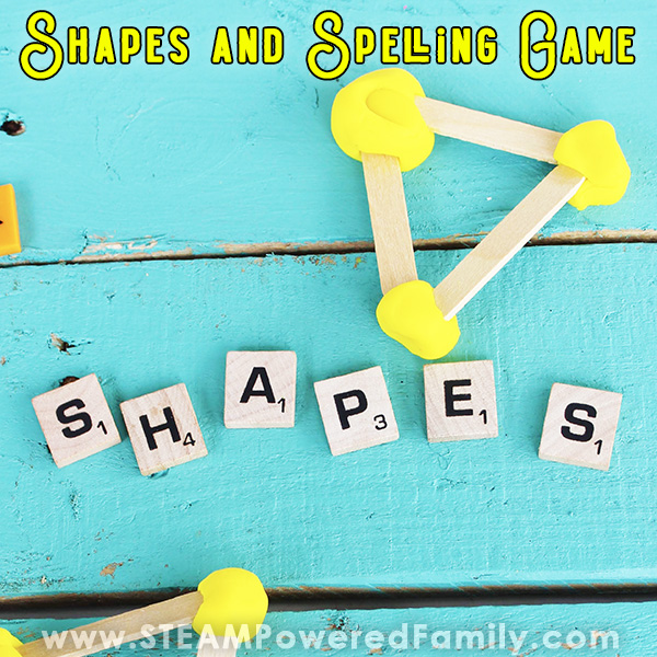 On a teal blue wood slate background sits Scrabble letter tiles spelling out the word SHAPES. Above it sits a triangle shape made out of craft sticks and yellow play dough. Overlay Text says Shapes and Spelling STEM Challenge