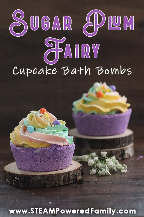 On a dark wood background sits two tree slices. Between the slices are small white babies breath flowers. On the slices are purple cupcake shaped bath bombs with whipped icing soap toppers in pink, yellow and green. Overlay text says Sugar Plum Fairy Cupcake Bath Bombs
