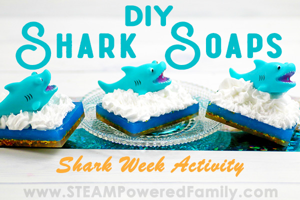 On a white background with a glittery turquoise foil strip sits three soaps in a row with a dark base, blue middle, and white frothy waves with a shark cresting out of the waves. Overlay text in teal says DIY Shark Soaps and in orange Shark Week Activity