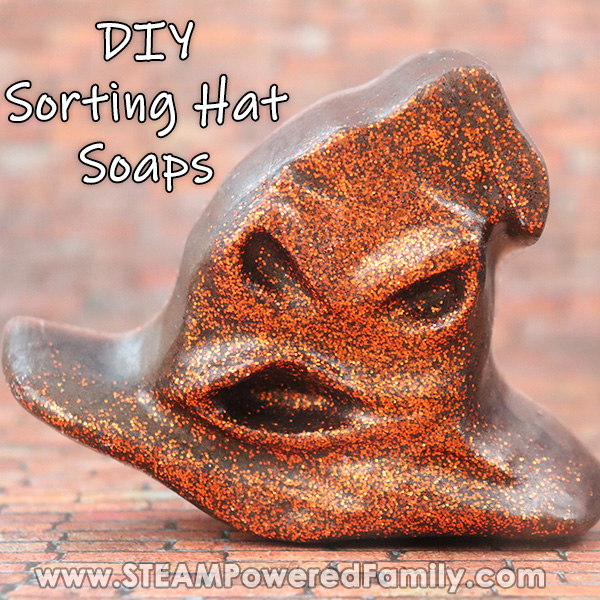 A Sorting hat soap with glitter sits on a brick background. Overlay text says DIY Sorting Hat Soap