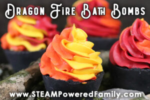 Black cupcake bath bombs with red, yellow and orange whipped soap topping are displayed with overlay text Dragon Fire Bath Bombs