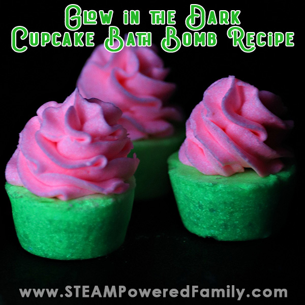 On a black background 3 cupcake bath bombs glow pink and green in the darkness. Overlay Text says Glow in the Dark Bath Bombs Recipe