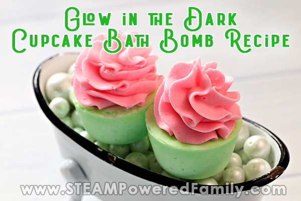 Two pink and green cupcake bath bombs are in a clawfoot tub filled with pearls. Overlay text says Glow in the Dark Cupcake Bath Bombs Recipe