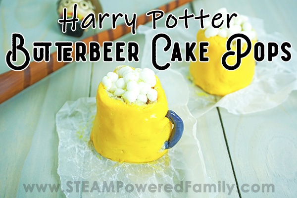On a white background sits 2 cake pops shaped like butterbeer mugs with yellow bodies, white fluffy topping and grey handles. A wand lays in the back. Overlay text says Harry Potter Butterbeer Cake Pops
