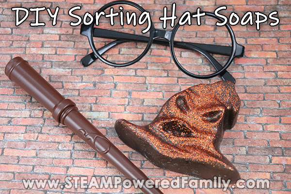 On a brick background sits round Harry Potter glasses, a wand and a glittery Sorting Hat soap. Overlay says DIY Sorting Hat Soaps