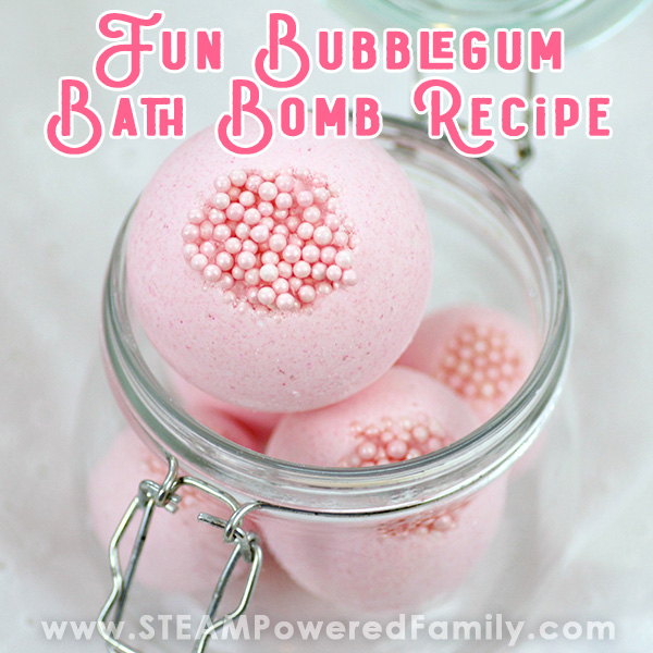 Pink bath bombs with pink bubble shaped pearls set in the ends, are stored in a jar on a white background. Overlay text says Fun Bubble Gum Bath Bomb Recipe