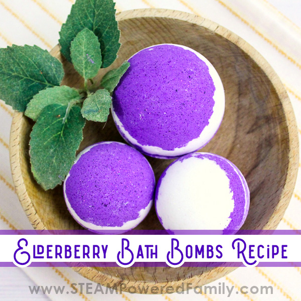Purple bath bombs are in a wood bowl on a white background. Overlay text says Elderberry Bath Bomb recipe, Monty Python inspired.