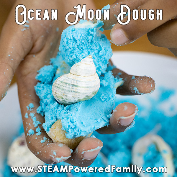 Ocean blue moon dough in a child's hand. Overlay text says Ocean Moon Dough