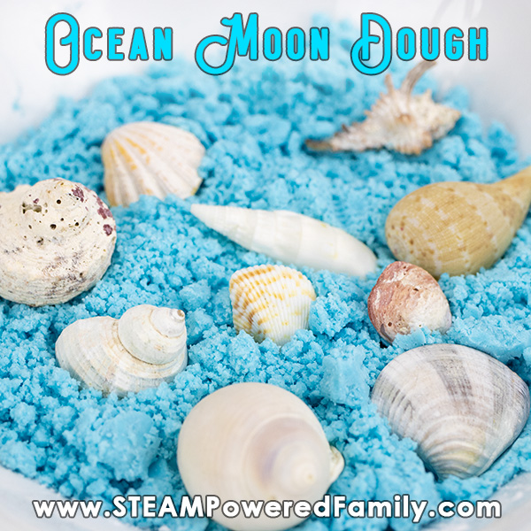 A bowl of ocean blue moon dough with sea shells, ready for playing