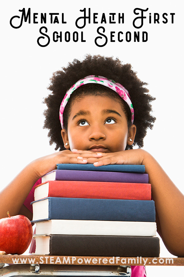 Girl rest on a stack of books, Mental Health First, School Second