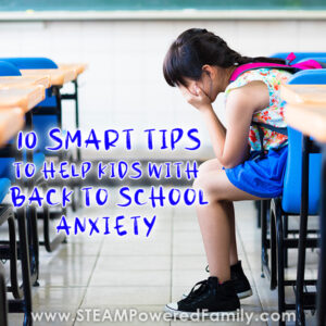 A female student of about 10 years old sits in an empty classroom at a desk in front of a chalkboard, her head in her hands, a pink backpack on her back. Overlay text at the top says: 10 Smart Ways To Help Students With Back To School Anxiety. Overlay text at the bottom says: www.STEAMPoweredFamily.com
