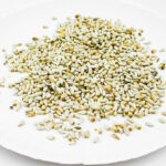 Spread bird seed on a paper plate
